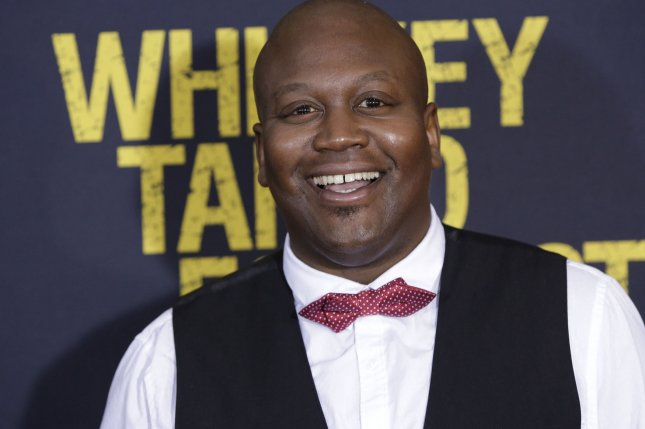 Tituss Burgess arrives on the red carpet at the Whiskey Tango Foxtrot world premiere at AMC Loews Lincoln Square 13 Theater on March 1, 2016 in New York City. Burgess has released his own brand of pinot noir following the success of his Unbreakable Kimmy Schmidt character's popular song, Peeno Noir. Photo by John Angelillo/UPI