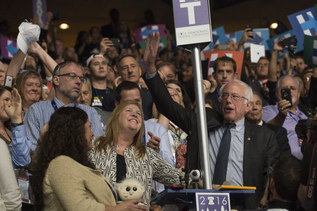 Vermont Sen. Bernie Sanders waves to delegates after placing Hillary Clinton's name into nomination at the Democratic National Convention. Sanders will return to the campaign trail to support Clinton with a Labor Day rally in New Hampshire. File Photo by Pete Marovich/UPI