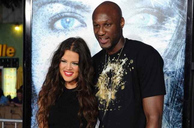 Lamar Odom (R) and Khloe Kardashian attend the Los Angeles premiere of Whiteout on September 9, 2009. Odom admitted to being unfaithful to Kardashian in the April 10 issue of Us Weekly. File Photo by Jim Ruymen/UPI
