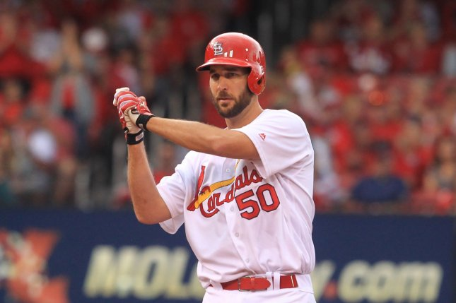 St. Louis Cardinals starting pitcher Adam Wainwright motions to his dugout after getting a hit. File photo by Bill Greenblatt/UPI