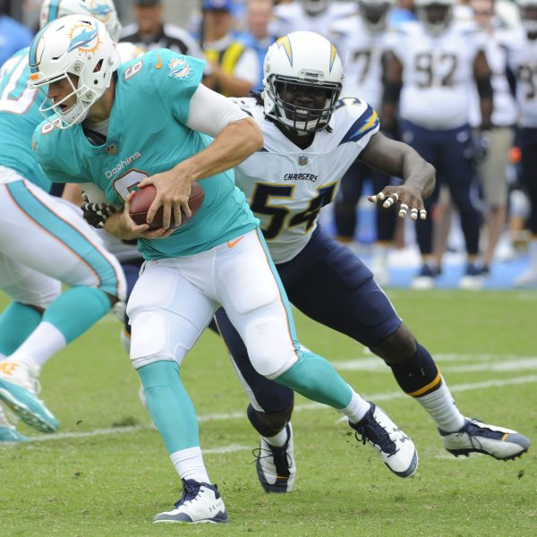 Miami Dolphins quarterback Jay Cutler gets away from Los Angeles Chargers' Melvin Ingram during their game last week. Photo by Lori Shepler/UPI