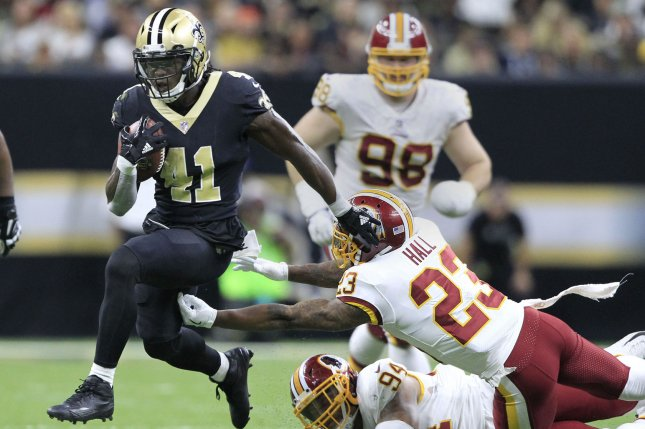 New Orleans Saints running back Alvin Kamara (41) runs over Washington Redskins linebacker Preston Smith (94) and safety DeAngelo Hall (23) on a 24 yard gain in the fourth quarter on November 19 at the Mercedes-Benz Superdome in New Orleans. Photo by AJ Sisco/UPI