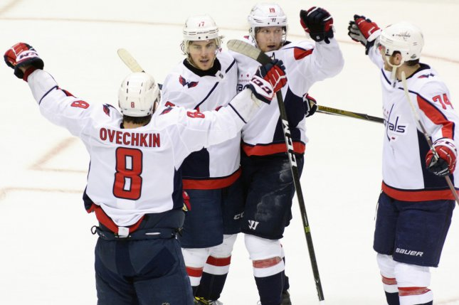 4f8c625b68d Washington Capitals left wing Alex Ovechkin (8) joins the celebration of Washington  Capitals right wing T.J. Oshie (77). Photo by Archie Carpenter UPI ...