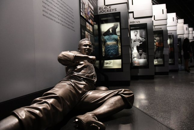 A sculpture of Jackie Robinson is part of the sports exhibit at the Smithsonian National Museum of African American History and Culture on September 14, 2016, in Washington, D.C. On October 23, 1945, Robinson, the first black baseball player hired by a major league team, was signed by the Brooklyn Dodgers. File Photo by Pat Benic/UPI