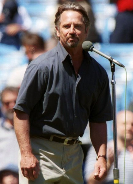 NYP2000082154 - 21 AUGUST 2000- NEW YORK, NEW YORK, USA: Actor Tom Wopat sings the National Anthem at the August 21, New York Yankees vs. Texas Rangers game at Yankee Stadium in New York. mc/lc/Laura Cavanaugh UPI