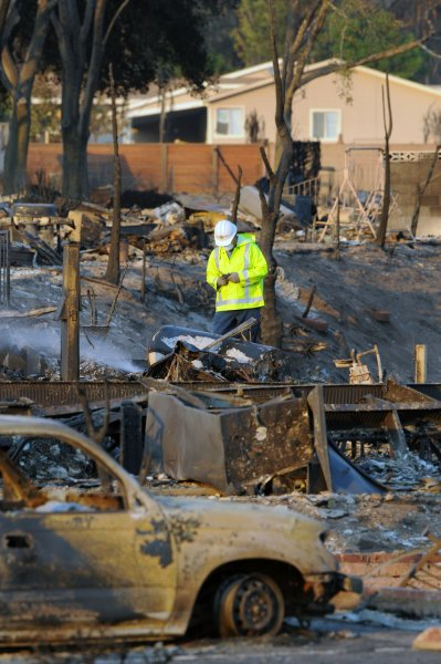 A worker shuts off water at the Oakridge Mobile Home Park in the Sylmar section of Los Angeles, California on November 16, 2008. The mobile home park burnt to the ground by a raging wildfire. More than 500 mobile homes were destroyed and 10,000 people fled as a wildfire described as the most devastating to hit Los Angeles in nearly half a century ripped through a city suburb on Saturday, officials said. (UPI Photo/Jim Ruymen)