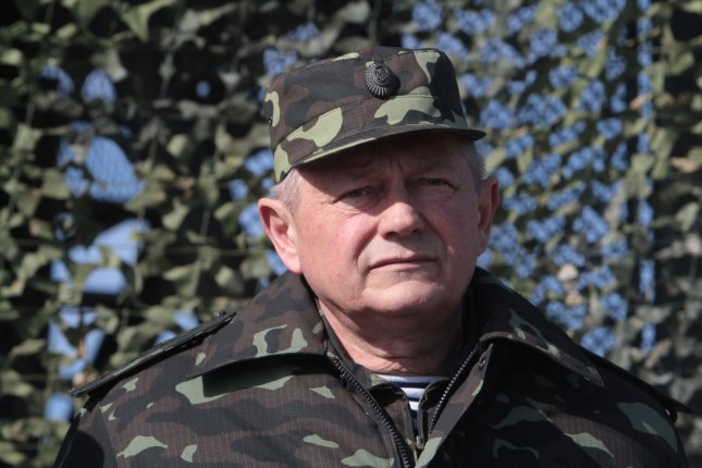 Ukrainian acting Defense Minister Ihor Tenyukh attends a military exercise near Goncharovsk village of the Chernigov area in Ukraine on March 14, 2014. (File/UPI/Sergey Starostenko)