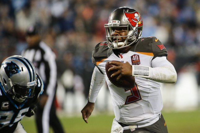 Tampa Bay Buccaneers quarterback Jameis Winston rushes for a second-half touchdown against the Carolina Panthers in an NFL football game at Bank of America Stadium in Charlotte, North Carolina on January 3, 2016.Carolina won 38-10. UPI/Nell Redmond .
