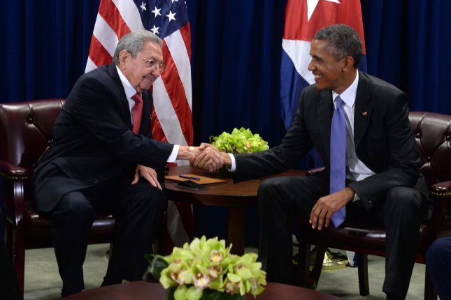 U.S. President Barack Obama (R) shakes hands with Cuban President Raul Castro during meeting at the United Nations Headquarters in New York last year. Pool Photo by Anthony Behar/UPI