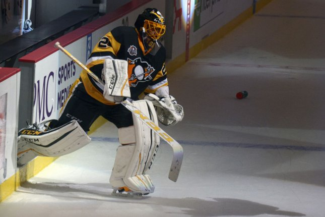 Pittsburgh Penguins goalie Marc-Andre Fleury (29) stopped all 28 shots he faced, and Conor Sheary capped a four-goal comeback when he scored with 2:56 left in regulation to give the Penguins a 4-3 win. File Photo by Archie Carpenter/UPI