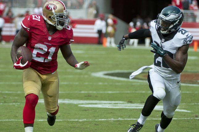 Former San Francisco 49ers running back Frank Gore (21) and former Philadelphia Eagles safety Earl Wolff (28) are now teammates after Wolff signed Monday with the Indianapolis Colts. File photo by Terry Schmitt/UPI