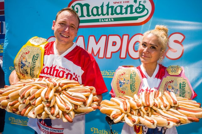 Joey Chestnut and Miki Sudo successfully defend their Nathan's hot dog eating titles Thursday in Coney Island, N.Y. Chestnut ate 71 hot dogs and Sudo consumed 31 weiners. Photo by Steven Ferdman/UPI