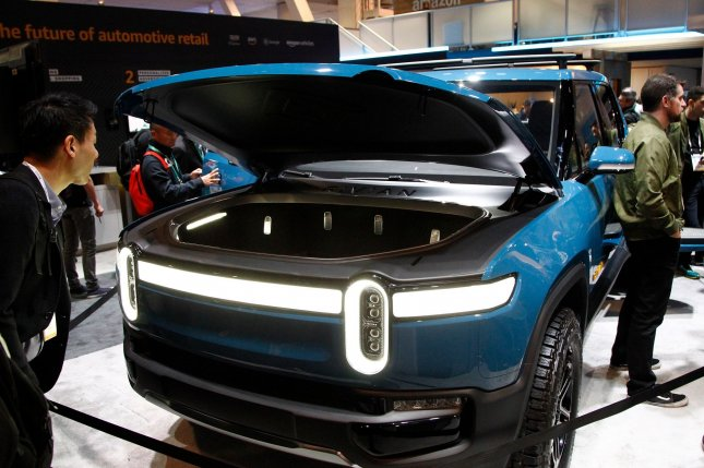 Attendees get a closeup view of the Rivian R1T electric pickup truck on display at the Amazon WS booth during the 2020 International CES at the Las Vegas Convention Center on January 9. Rivian announce a $2.5 billion investment on Friday. File Photo by James Atoa/UPI