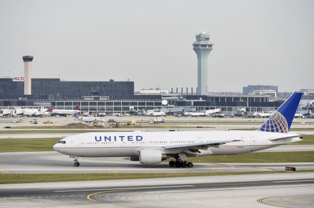 A United Airlines jetliner is pictured at O'Hare International Airport in Chicago, Ill. A filing by the carrier Monday showed that it lost $7 billion last year amid declining demand related to COVID-19. File Photo by Brian Kersey/UPI