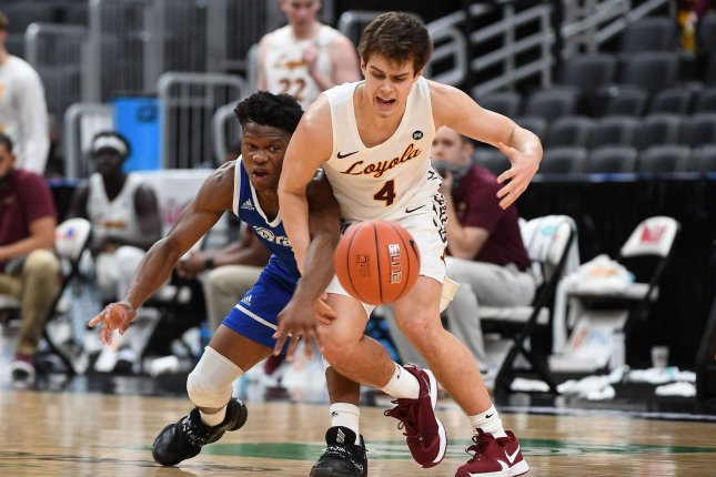 Loyola Chicago Ramblers player Braden Norris (4) tries to regain control of the basketball after Drake Bulldogs guard Joseph Yesufu picked it away during the Missouri Valley Conference men's basketball tournament in St. Louis, Mo., on March 7. Photo by Doug Devoe/UPI