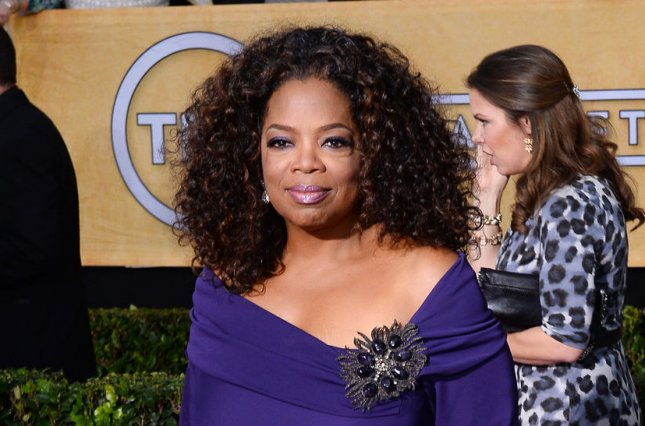 Actress Oprah Winfrey arrives for the 20th annual SAG Awards held at the Shrine Auditorium in Los Angeles on January 18, 2014. the Screen Actors Guild Awards are telecast live on TNT. UPI/Jim Ruymen
