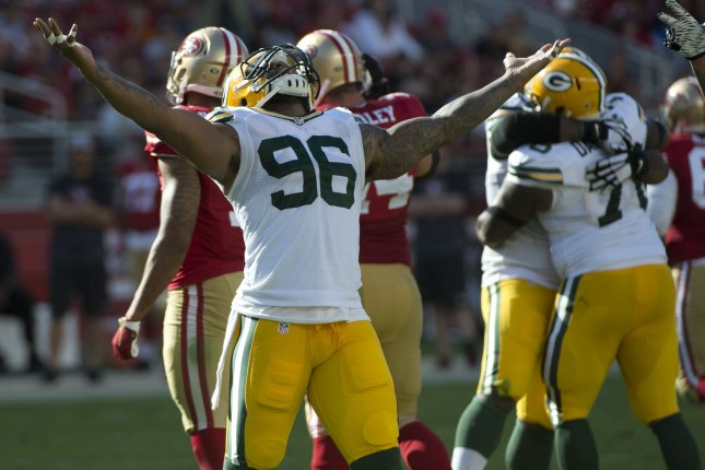 Green Bay Packers Mike Neal (96) and others celebrate a 4th down sack of San Francisco 49ers QB Colin Kaepernick (7) in the fourth quarter at Levi's Stadium in Santa Clara, California on October 4, 2015. Kaepernick was sacked six times as the Packers defeated the 49ers 17-3. Photo by Terry Schmitt/UPI