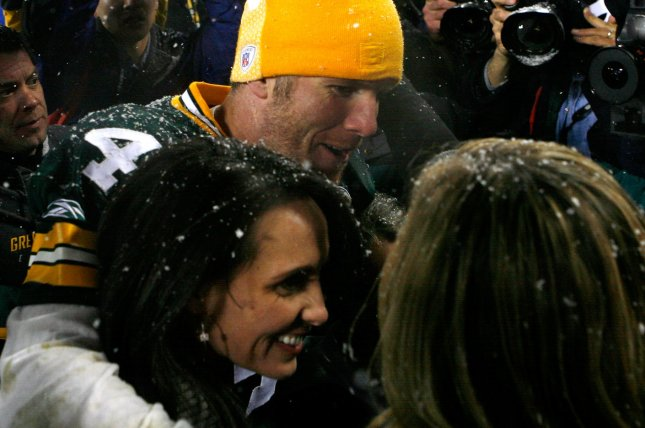Green Bay Packers quarterback Brett Favre hugs his wife Deanna (L) and daughter Brittany (R) after defeating the Seattle Seahawks in the NFC Divisional Playoff at Lambeau Field in Green Bay, Wisconsin on January, 12, 2008. The Packers won 42-20. (UPI Photo/Brian Kersey)