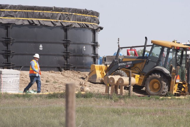 Federal Reserve Bank of Dallas says the worst may be over for Texas oil, but there's still work left to be done for full recovery. Photo by Gary C. Caskey/UPI