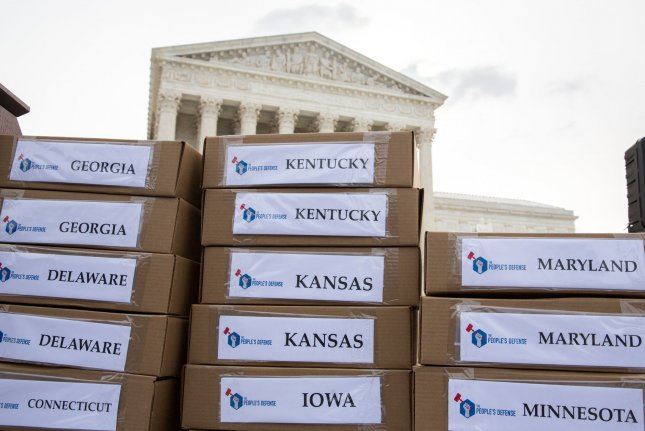 Boxes of petitions calling for senators to reject the nomination of federal judge Neil M. Gorsuch to the Supreme Court are stacked in front of the high court on Wednesday before a news conference organized by The People's Defense -- a coalition including NARAL, MoveOn, End Citizens United, and others. Photo by Erin Schaff/UPI