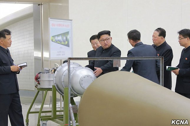This image released on September 3 by the North Korean official news service KCNA, shows North Korean leader Kim Jong Un during a briefing by scientists at the Nuclear Weapons Institute on the details of the country's nuclear weaponization program. Photo courtesy of KCNA/UPI