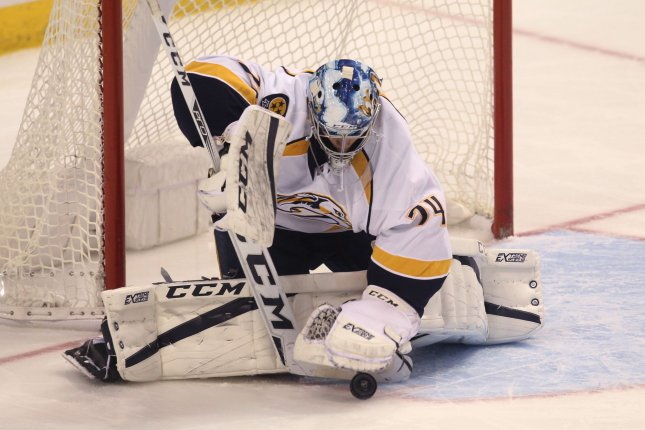 Nashville Predators goaltender Juuse Saros covers up a shot on goal by the St. Louis Blues in the first period at the Scottrade Center in St. Louis on December 30, 2016. File photo by Bill Greenblatt/UPI