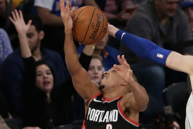CJ McCollum and the Portland Trail Blazers take on the Los Angeles Clippers on Thursday. Photo by John Angelillo/UPI