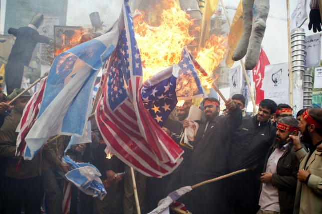 Demonstrators burn the flags of Israel and the United States during a rally in front of the former U.S Embassy compound in Tehran, Iran. File Photo by Maryam Rahmanian/UPI