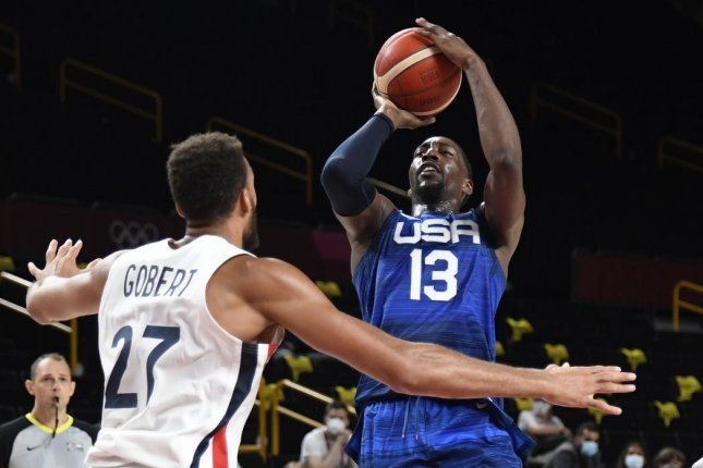 Team USA's Bam Adebayo shoots between France's Rudy Gobert (L) and Timothe Luwawu Kongbo during a men's basketball game at the 2020 Summer Games on Sunday in Saitama, Japan. Photo by Mike Theiler/UPI