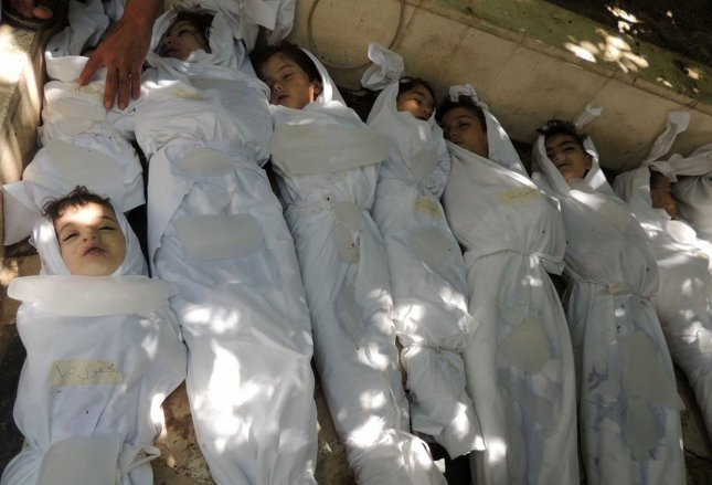 Dead children lie on the ground as Syrian rebels claim they were killed in a toxic gas attack by pro-government forces in eastern Ghouta, on the outskirts of Damascus in Syria on August 21, 2013. UPI/Diaa El Din