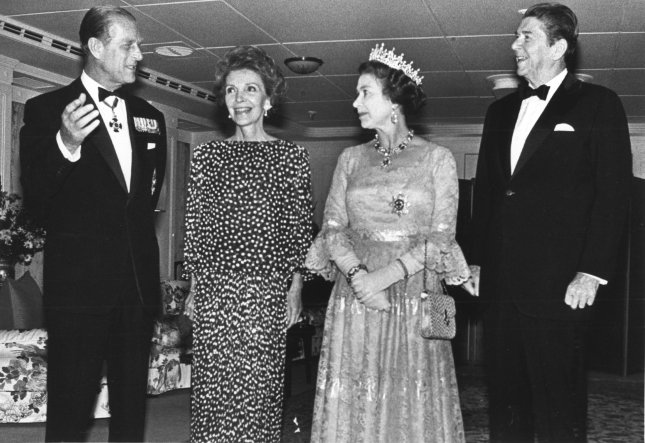 Former President Reagan and his wife Nancy celebrated their 31st wedding anniversary aboard the royal yacht Britannia as guests of Queen Elizabeth II and her husband Prince Philip here March 4, 1983. President Reagan and wife Nancy pose for photo aboard the yacht with Queen Elizabeth II and Prince Philip. The Royal Marine band played the Anniversary Waltz for the Reagan's. (UPI Photo/Don Rypka/Files).