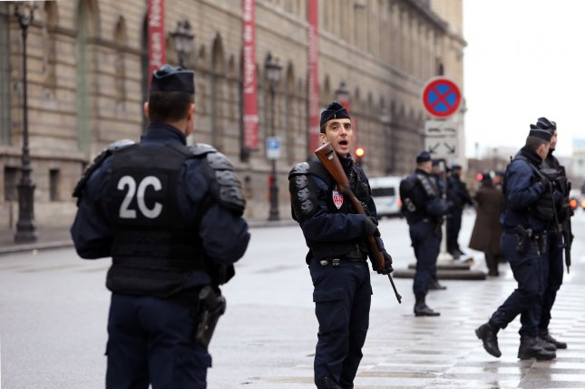 French security forces keep watch in front of the Louvre Museum in Paris on February 3 after it was closed following an attack in the Louvre's underground mall. France remains under a state of emergency following the deadly attacks by the Islamic State on Paris in November 2015 in which 130 people died. On Thursday, officials said one person was arrested in the southern town of Grasse following a shooting at the Tocqueville high school in which several were injured. File Photo by Maya Vidon-White/UPI