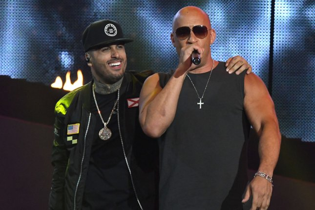 Nicky Jam (L) and Vin Diesel perform during the 2017 Billboard Latin Music Awards on April 27. Photo by Gary I Rothstein/UPI