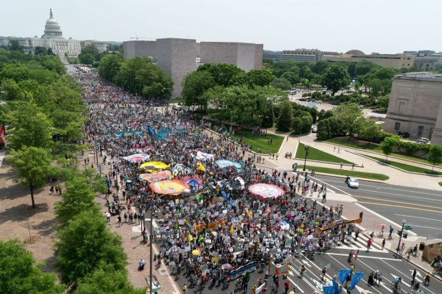 Thousands gather for The People's Climate Movement march near the U.S. Capitol in Washington on Saturday. There were over 375 sister marches planned across the United States and around the world, from Japan to Brazil. Photo Ken Cedeno/UPI