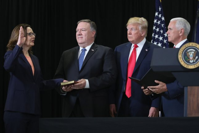 Gina Haspel is sworn in as CIA director Monday as U.S. Secretary of State Mike Pompeo (2nd-L), President Donald Trump and Vice President Mike Pence look on at agency headquarters in Langley, Virginia. Photo by Mark Wilson/Pool