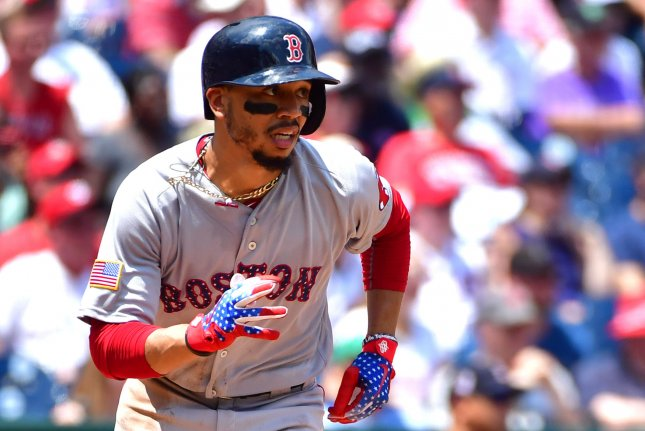 Boston Red Sox right fielder Mookie Betts (50) runs after hitting a single against the Washington Nationals on July 4, 2018 at Nationals Park in Washington, D.C. Photo by Kevin Dietsch/UPI