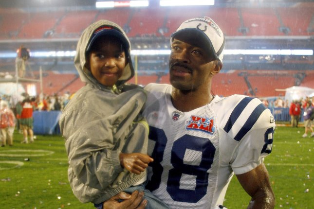 Former Indianapolis Colts wide receiver Marvin Harrison (88) carries his son in celebration after Super Bowl XLI. His son, Marvin Harrison Jr., committed to Ohio State. File Photo by Gary C. Caskey/UPI
