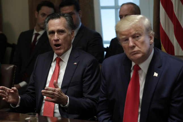 U.S. Sen. Mitt Romney (L), R-Utah, and President Donald Trump meet at the White House on Friday with stakeholders related to youth vaping and the electronic cigarettes. Photo by Yuri Gripas/UPI