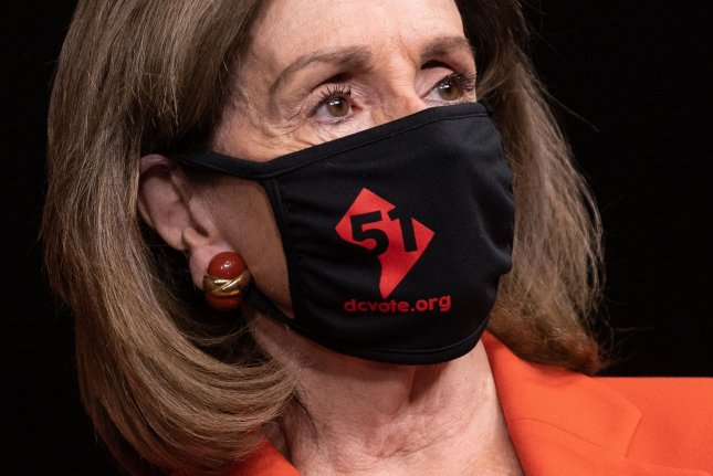 Speaker of the House Nancy Pelosi, D-Calif., wears a DC 51st state mask as she attends a press conference on voting rights Friday on Capitol Hill. Photo by Kevin Dietsch/UPI