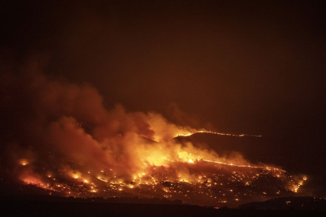 As wildfires become more frequent and intense, the carbon storage capabilities of global forests are suffering. File Photo by Bob Strong/UPI