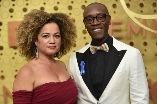 Don Cheadle (R) and his Bridgid Coulter arrive for the 71st annual Primetime Emmy Awards in September 2019. The actor detailed playing basketball with Barack Obama on The Late Late Show. File Photo by Christine Chew/UPI