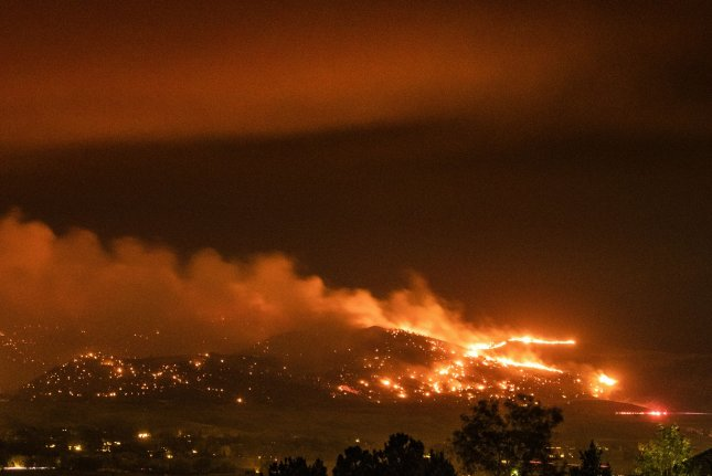 While the amount of carbon released into the atmosphere from wildfires, such as the CalWood wildfire in Colorado, can't be controlled by humans, a range of other sources can be controlled -- which could prevent millions of deaths in the coming decades, researchers say. File Photo by Bob Strong/U20