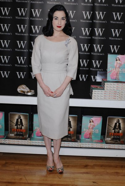 American burlesque artist/model Dita Von Teese attends a signing of her book Burlesque And The Art Of The Teese at Waterstone's, Piccadilly in London on November 22, 2007. (UPI Photo/Rune Hellestad)
