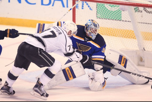 St. Louis Blues goaltender Jake Allen gets a skate on the puck before the stick of Los Angeles Kings Jeff Carter in the first period at the Scottrade Center in St. Louis on October 29, 2016. Photo by Bill Greenblatt/UPI