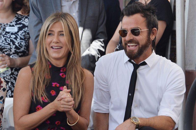Jennifer Aniston (L) and Justin Theroux attend Jason Bateman's Hollywood Walk of Fame ceremony on Wednesday. Photo by Jim Ruymen/UPI