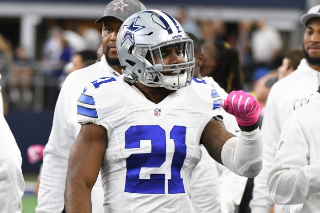 Dallas Cowboys running back Ezekiel Elliott celebrates his 60-yard  touchdown run against the Cincinnati Bengals during the first half at AT T  Stadium in ... f3f6c4360607