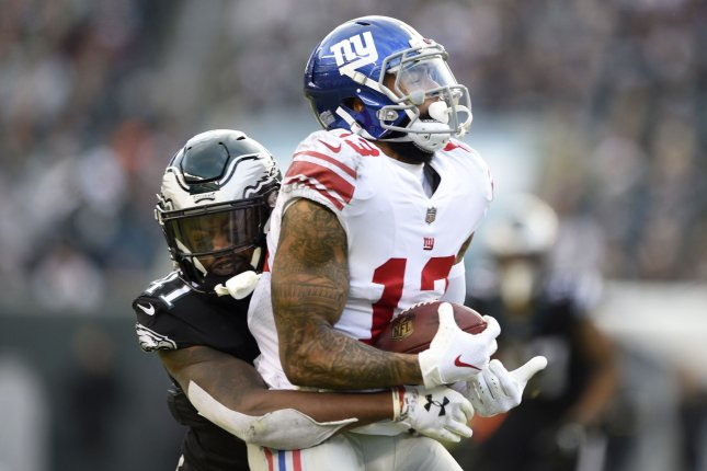 New York Giants receiver Odell Beckham is tackled by Philadelphia Eagles cornerback DeVante Bausby during their game at Lincoln Financial Field on November 25, 2018. Photo by Derik Hamilton/UPI