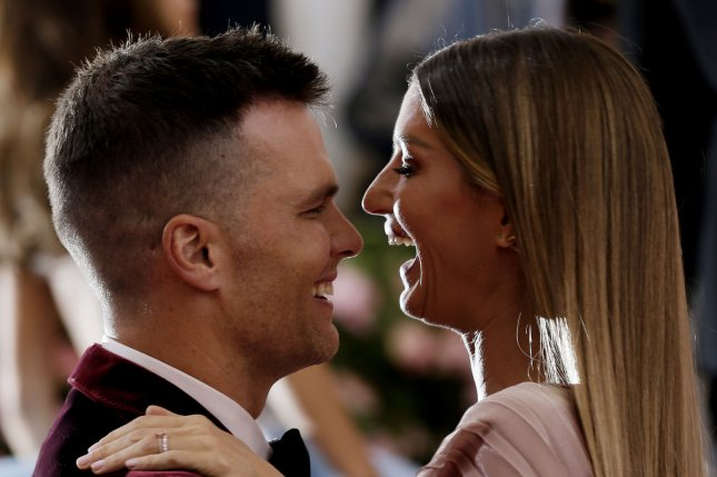 Tom Brady (L) and Gisele Bundchen have been house hunting in Greenwich, Conn., and Alpine, N.J. File Photo by John Angelillo/UPI