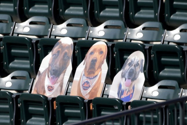 Atlanta Braves outfielder Adam Duvall hit a home run into a cardboard version of teammate Jeff McNeil's dog Willow (R) during a win against the New York Mets on Saturday at Citi Field in New York City.  Photo by John Angelillo/UPI