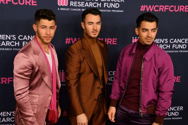 Nick Jonas, Kevin Jonas and Joe Jonas, from left to right, compete in gymnastics, track and field, and BMX racing in the NBC special Olympic Dreams featuring Jonas Brothers. File Photo by Jim Ruymen/UPI